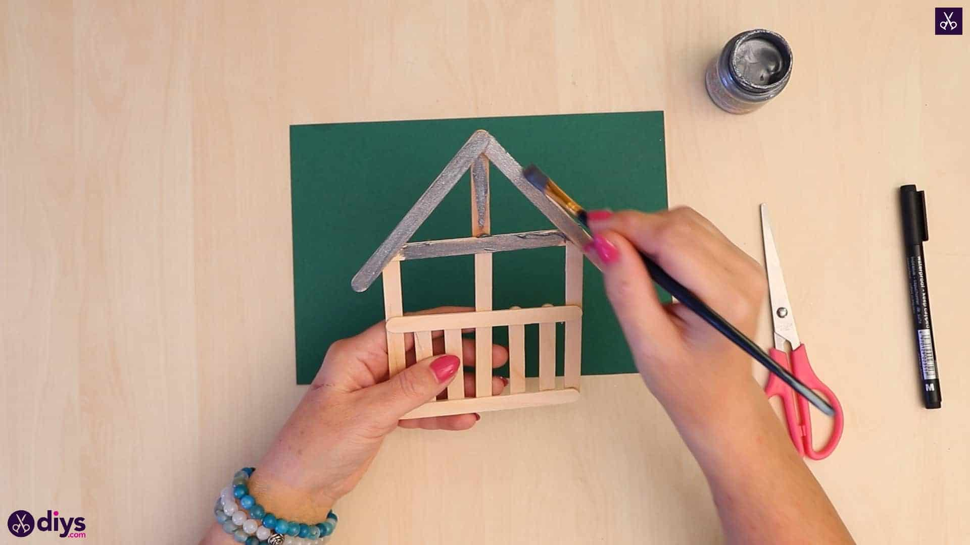 Popsicle stick house ornament start painting process