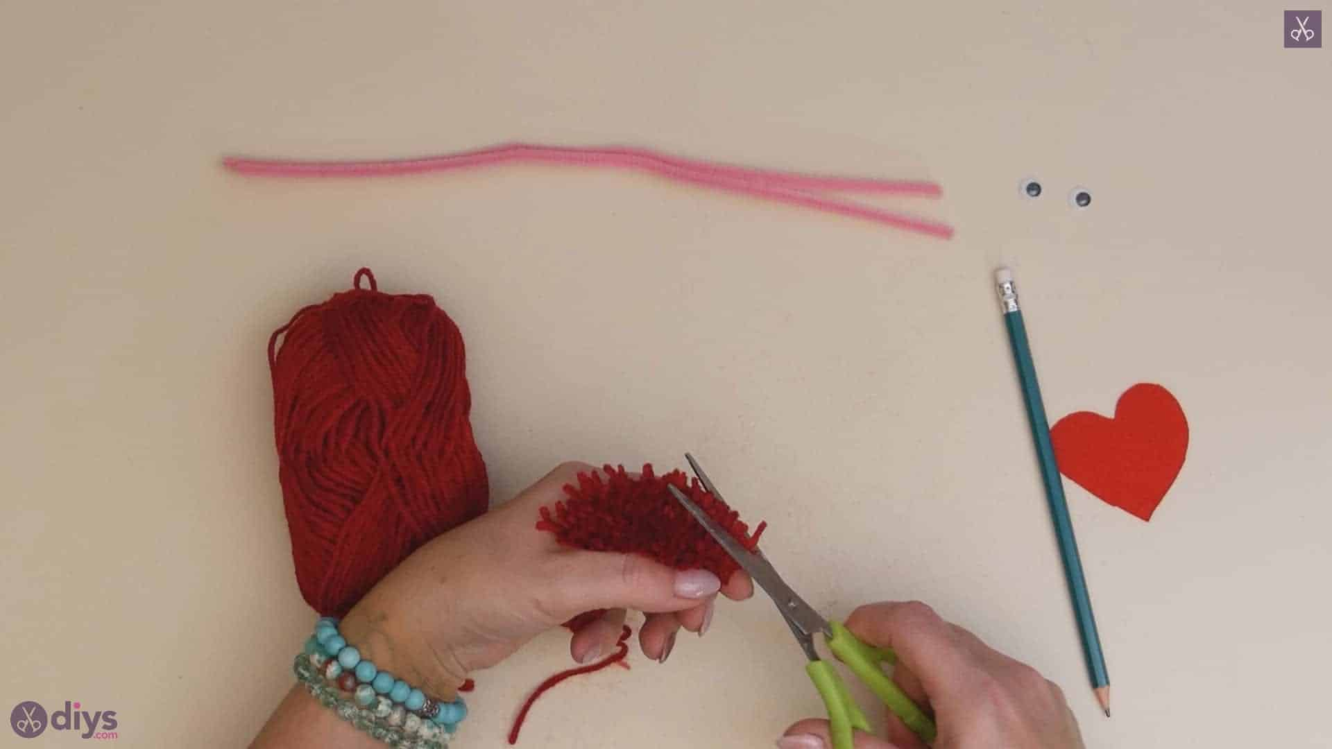 Diy pom pom love monster top yarn cutting