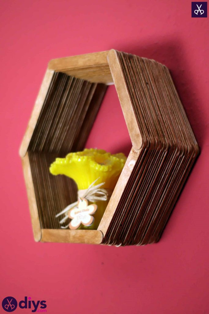 Diy popsicle stick hexagon shelf = glue gun