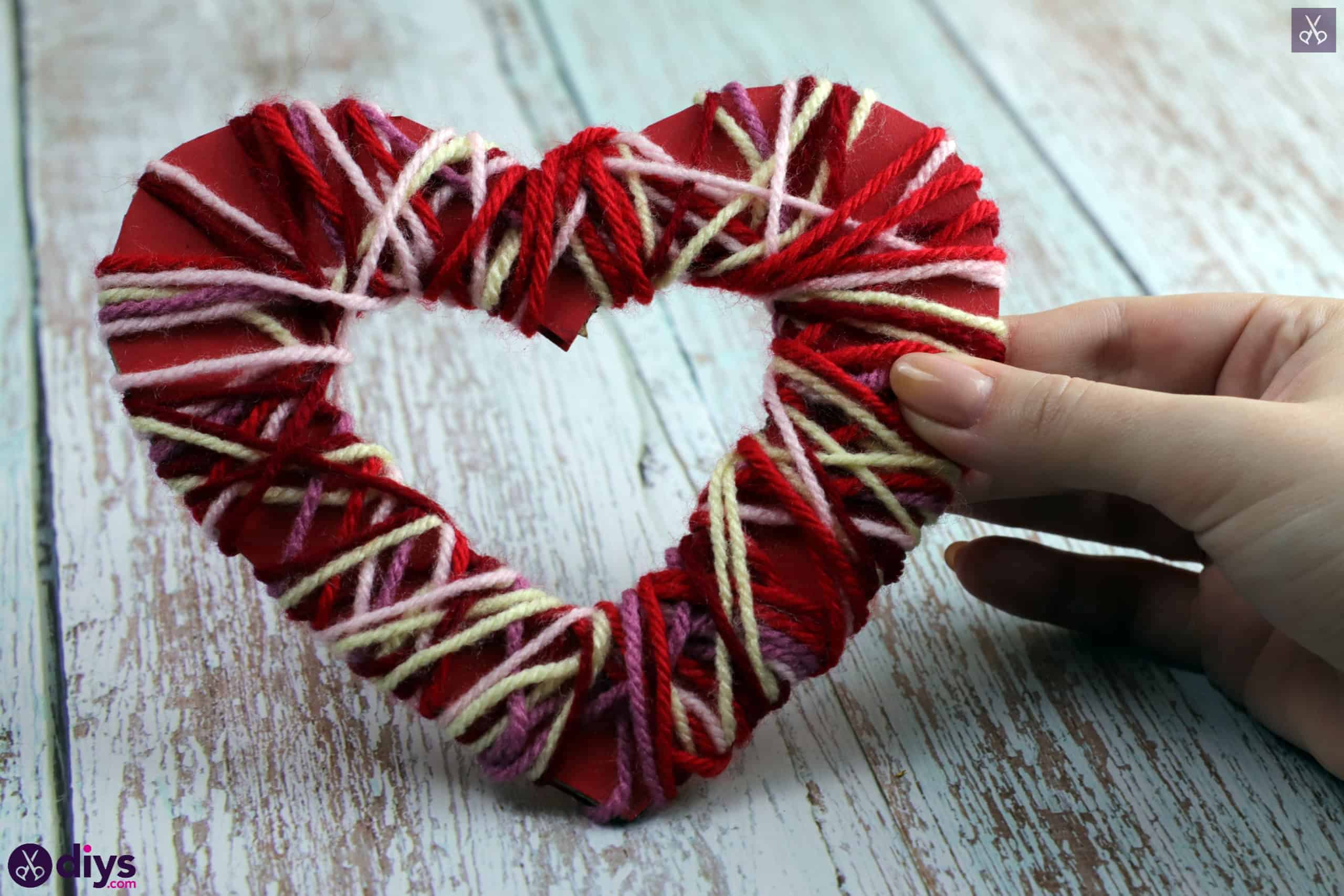 Diy yarn wrapped paper heart display