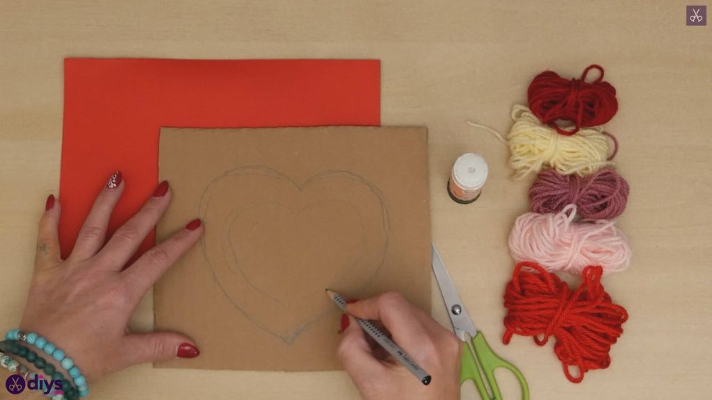 Diy yarn wrapped paper heart drawing