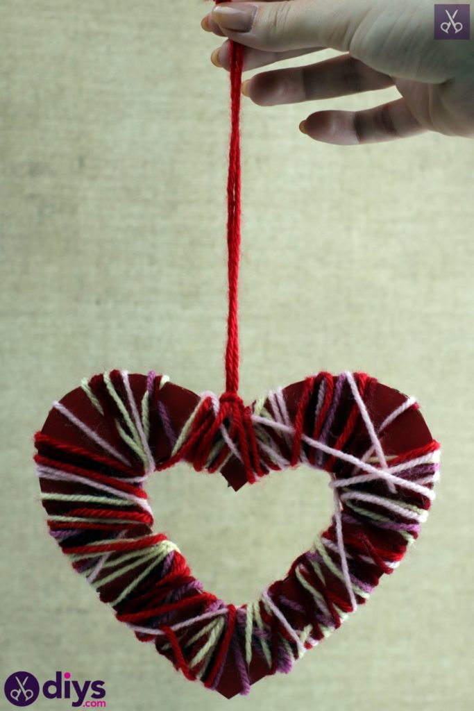 Diy yarn wrapped paper heart hang