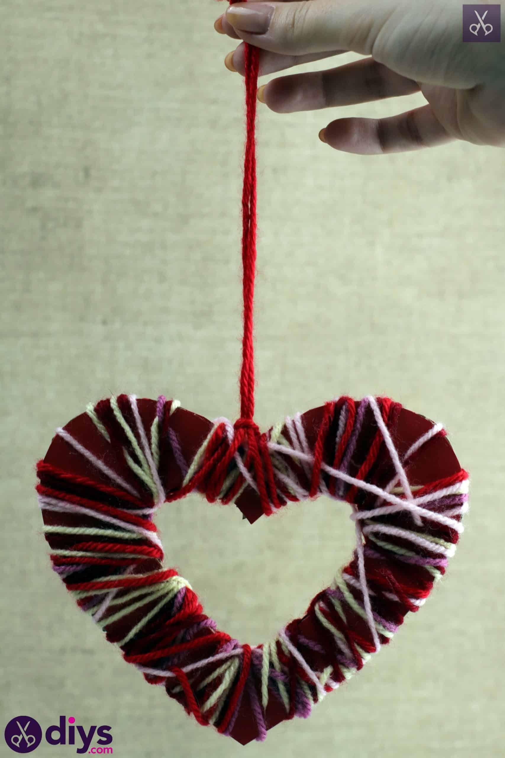 Diy yarn wrapped paper heart hang