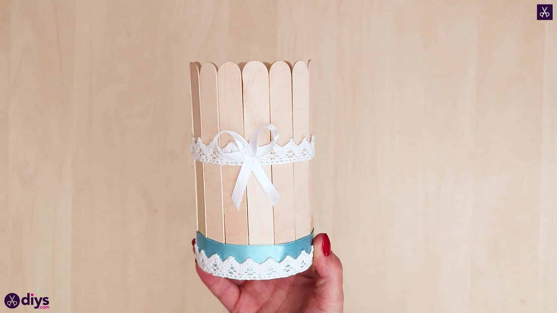Elegant popsicle stick covered tin container