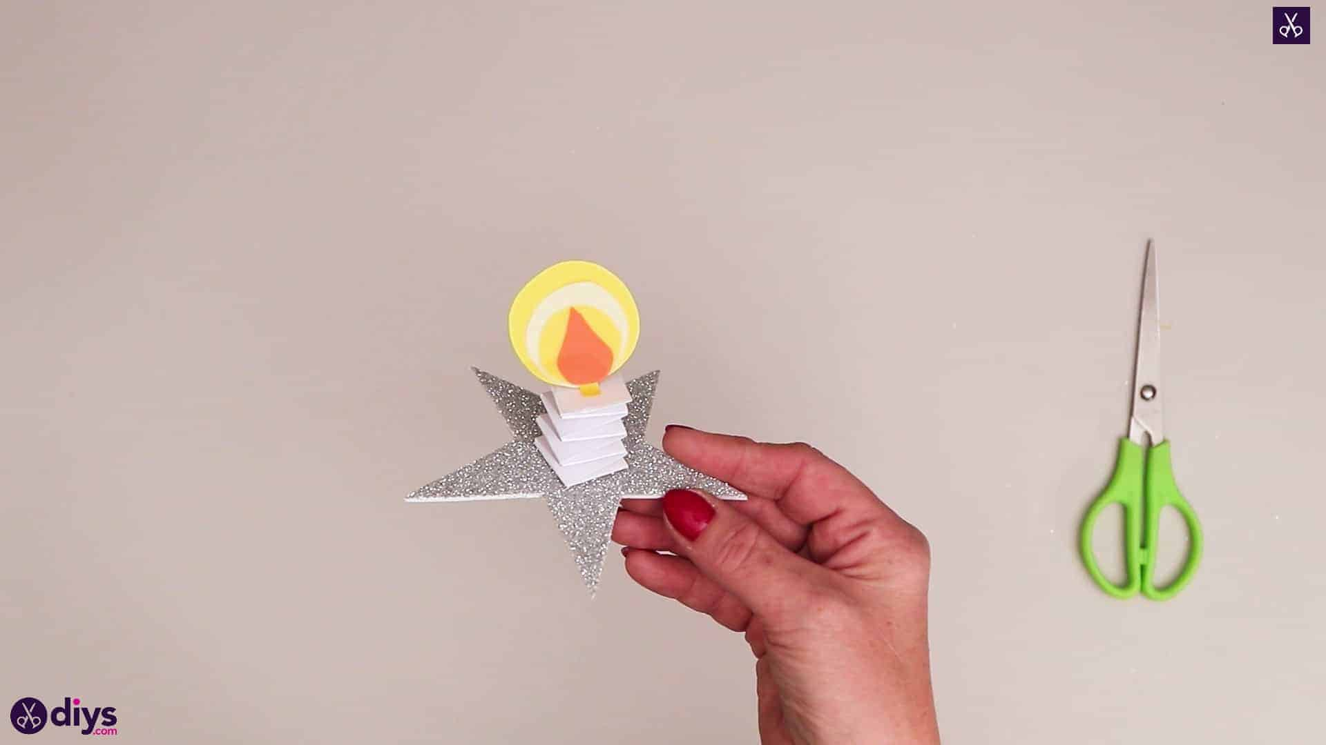 Paper candle on a star