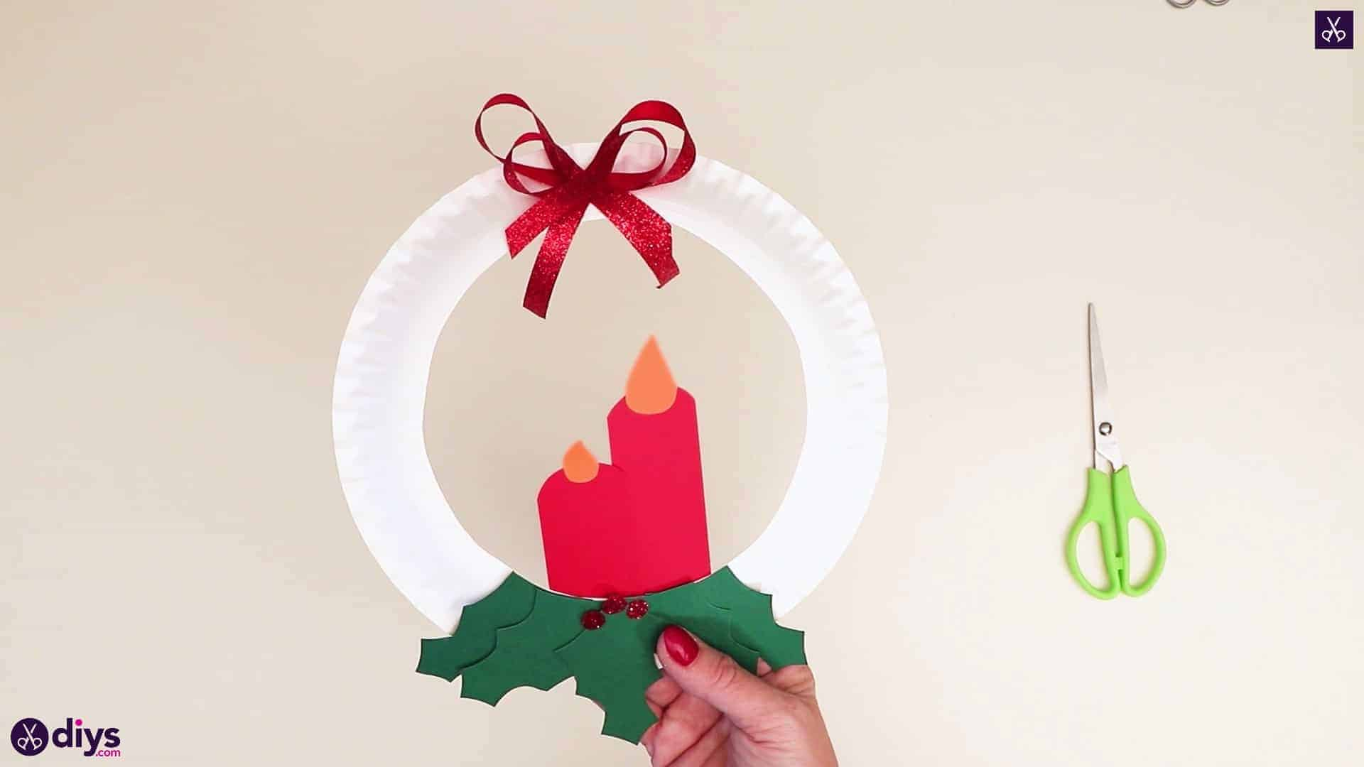 Paper plate wreath with a candle