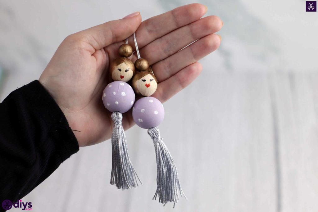 Wooden pearl doll display