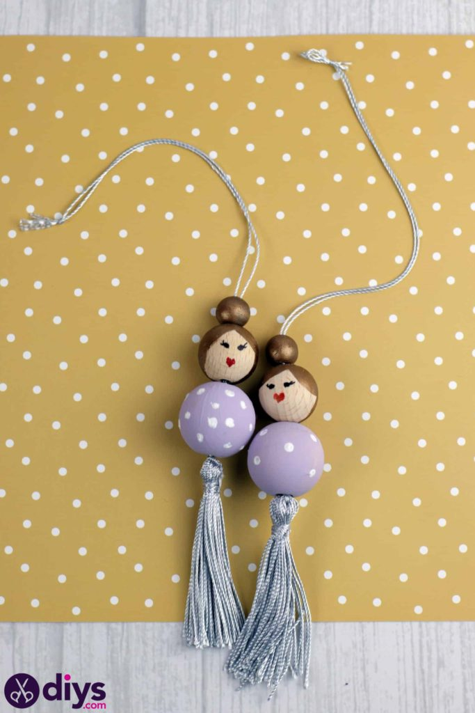 Wooden pearl doll hanging