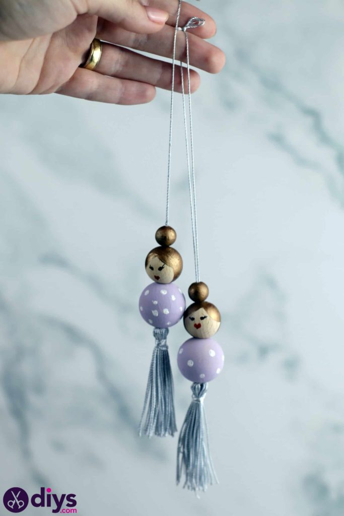Wooden pearl doll string