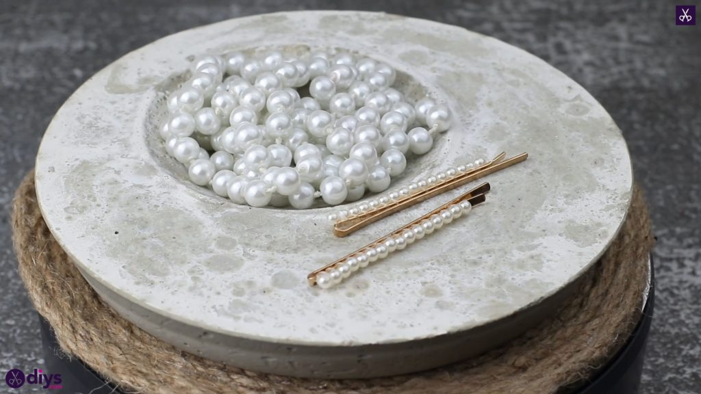 Diy concrete jewelry holder dish on table