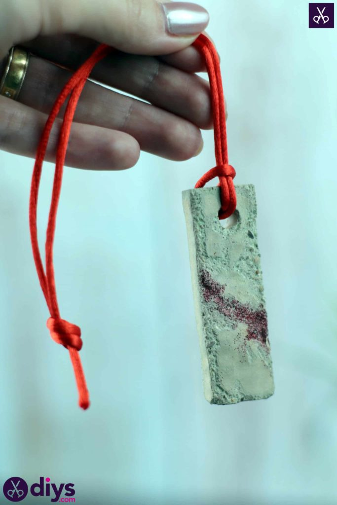 Diy concrete necklace with glitter red string