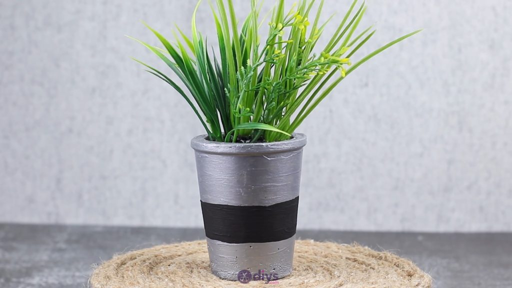 Tall concrete flower pot