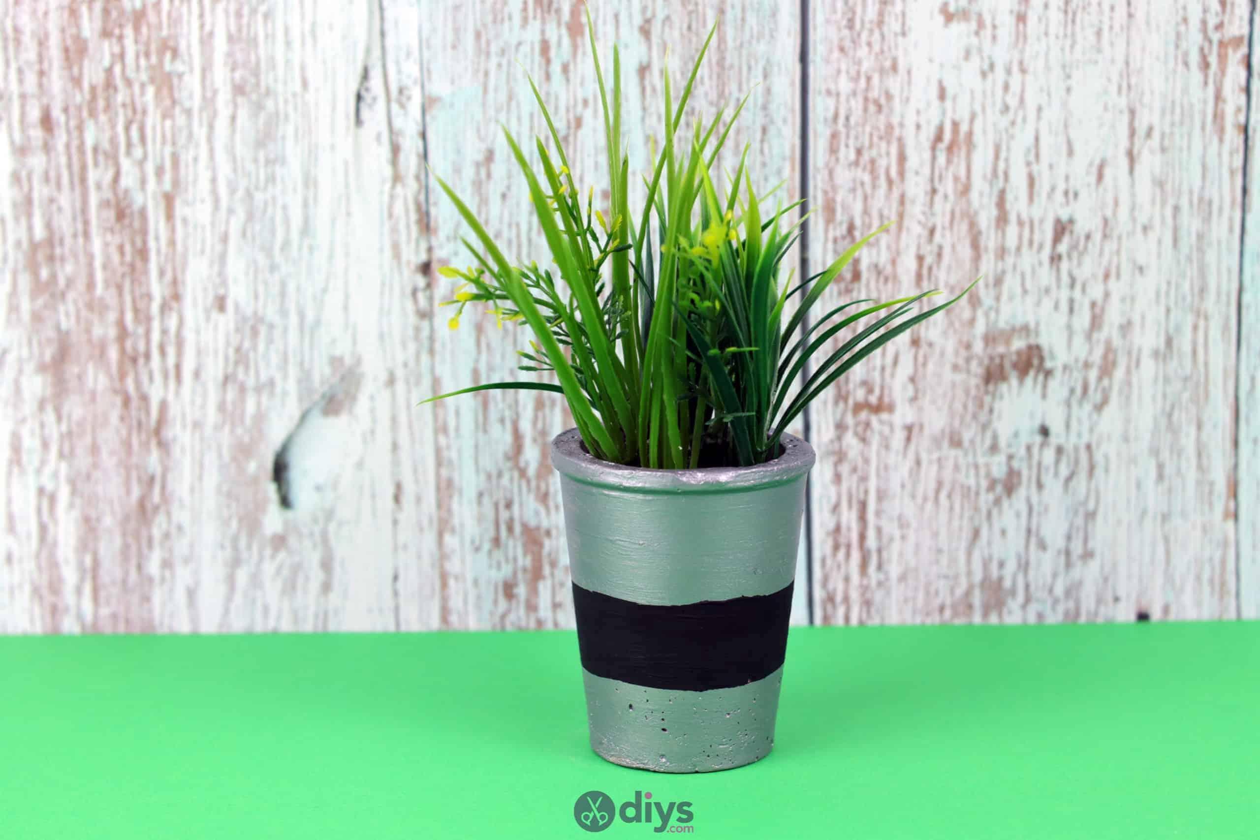 Tall concrete flower pot bold