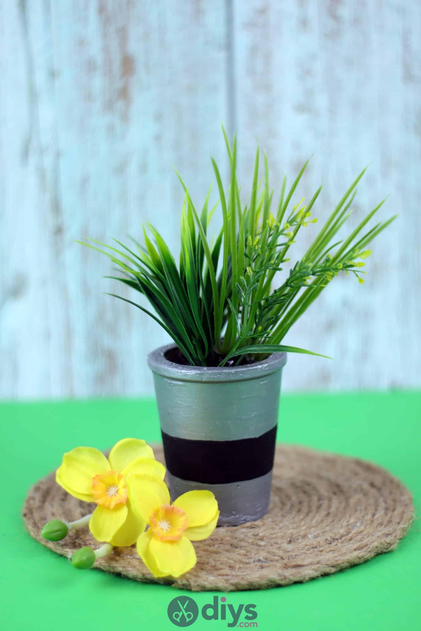 Tall concrete flower pot decpr
