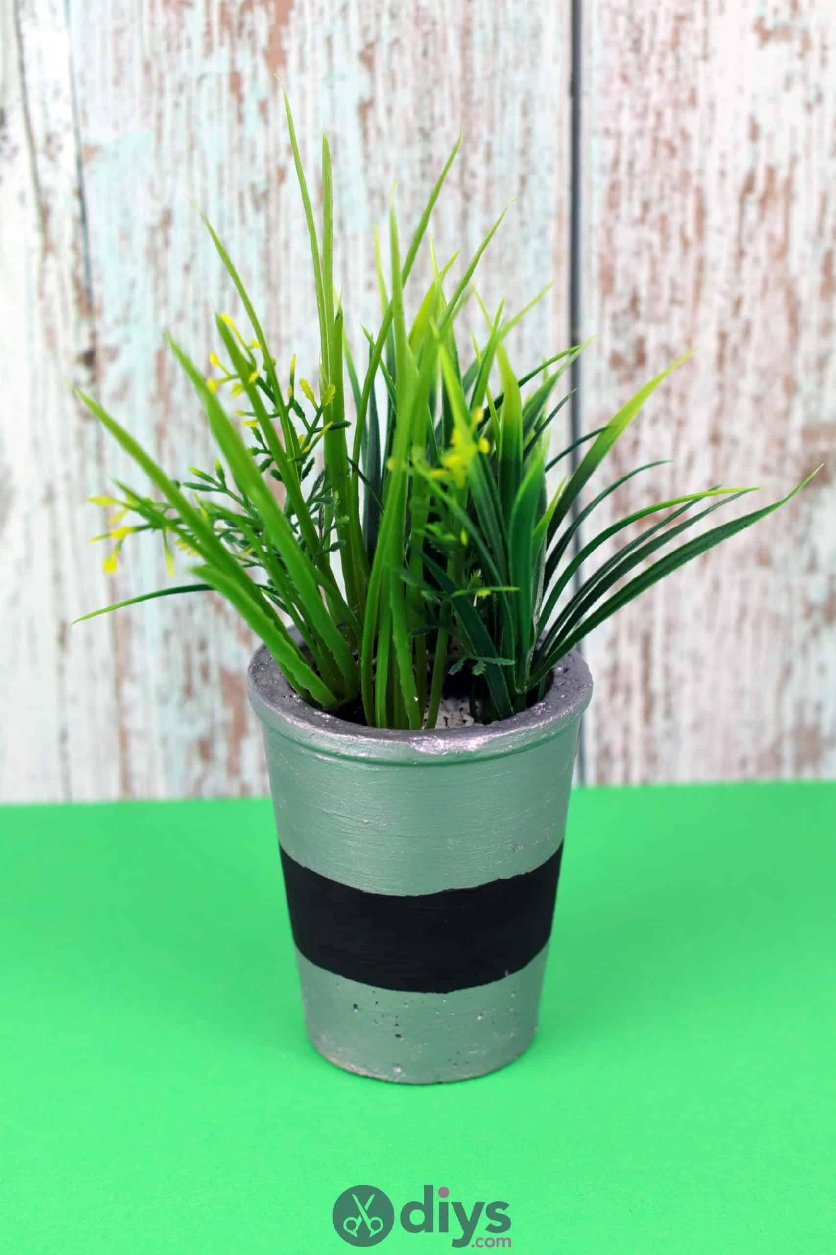 Tall concrete flower pot grey