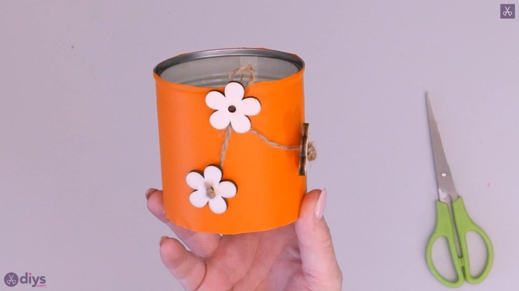 Tin can container with wooden flowers