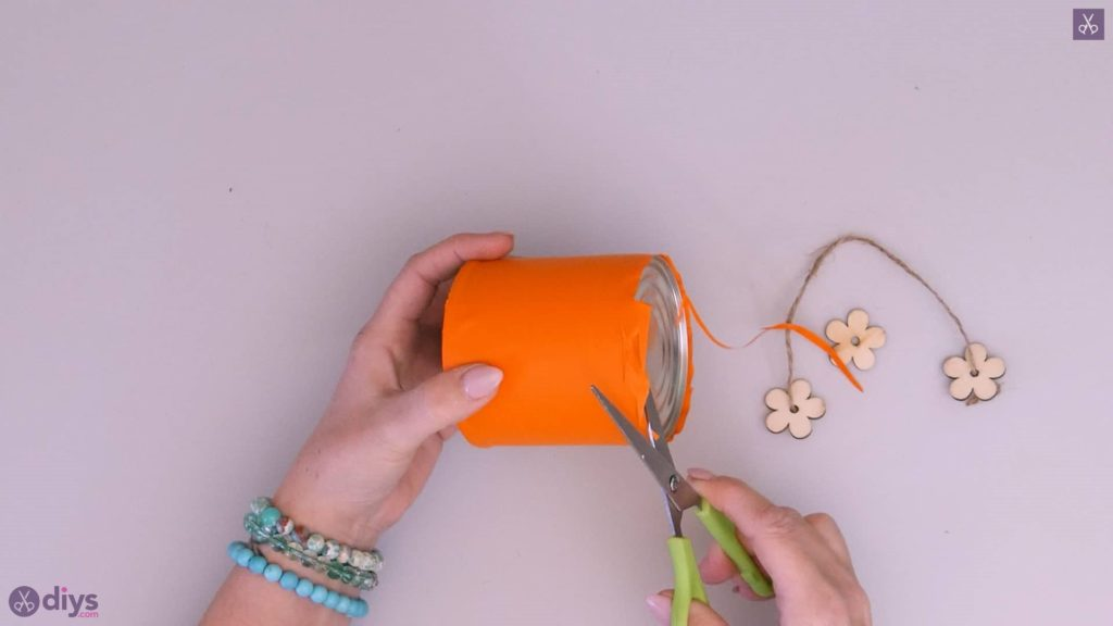 Tin can container with wooden flowers step 3d