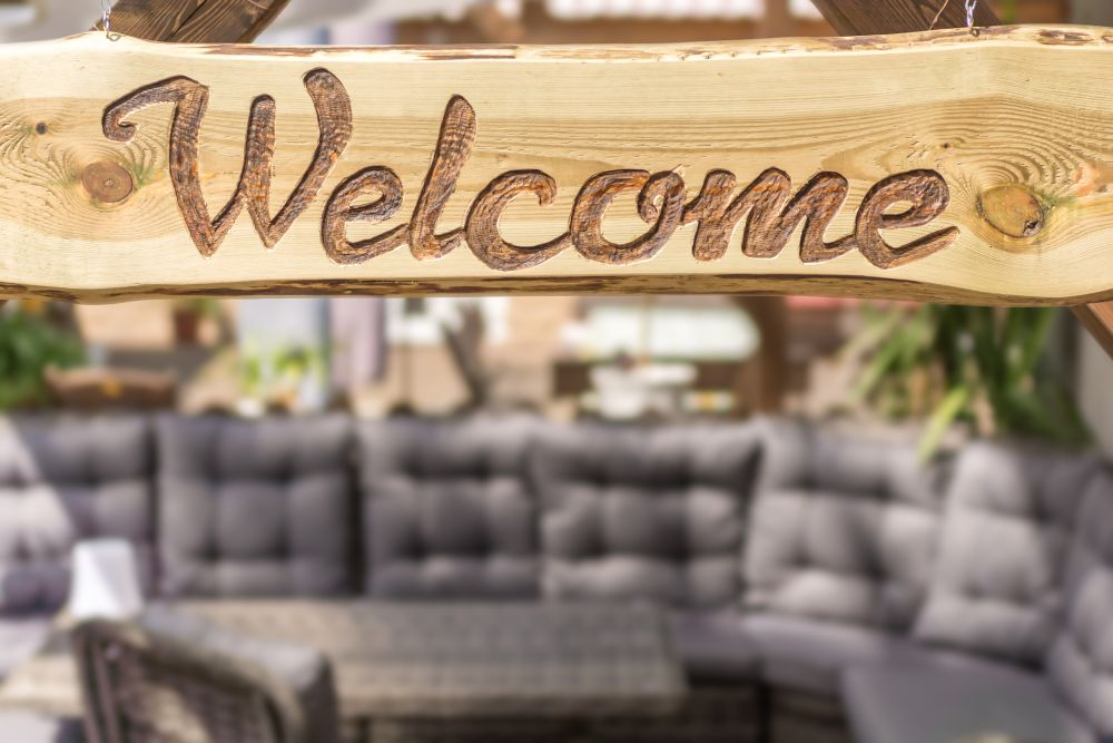 Etched in wood welcome sign