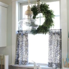 Natural greenery window wreath and half curtains