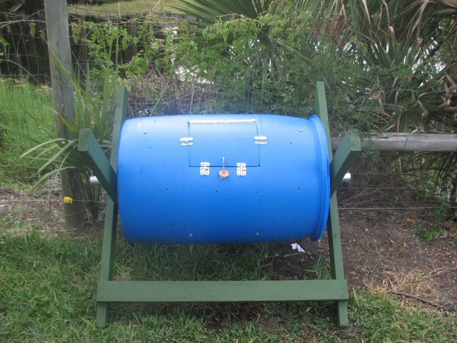 Plastic rain barrel compost bin in a frame