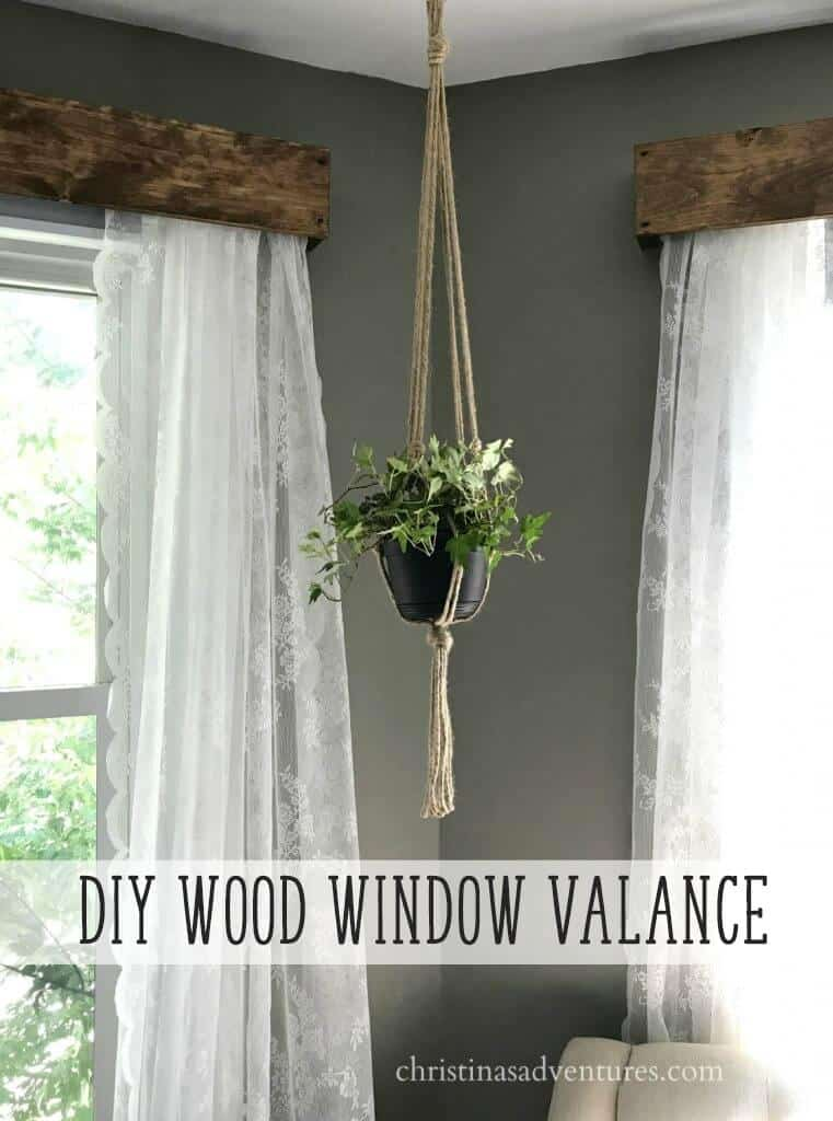 Reclaimed wood window valance with lace curtains
