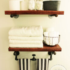 Stained wood and pipe rustic bathroom shelving