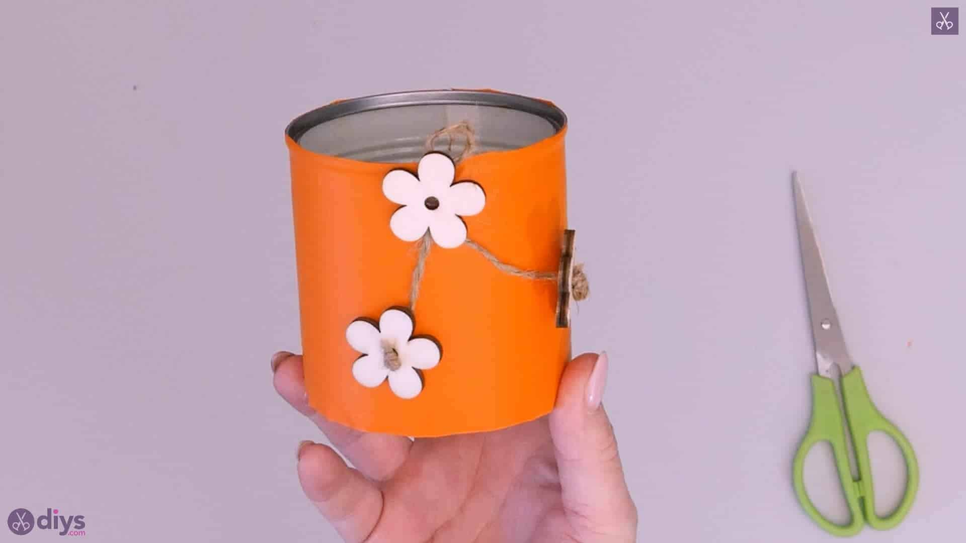 Tin container with wooden flowers