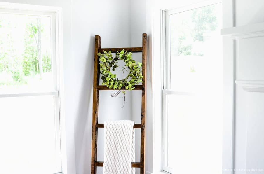Weathered wooden ladder blanket rack