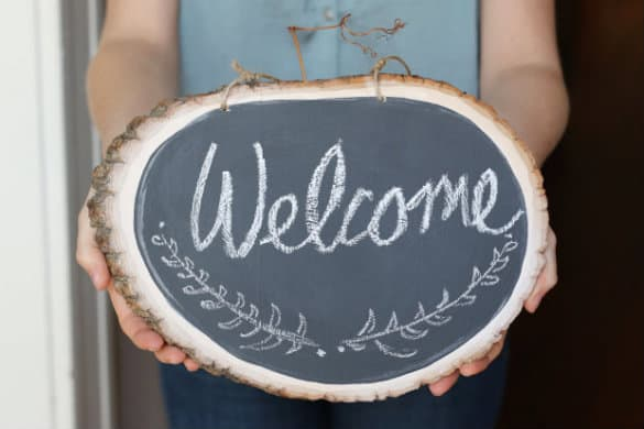 Wooden chalkboard welcome sign