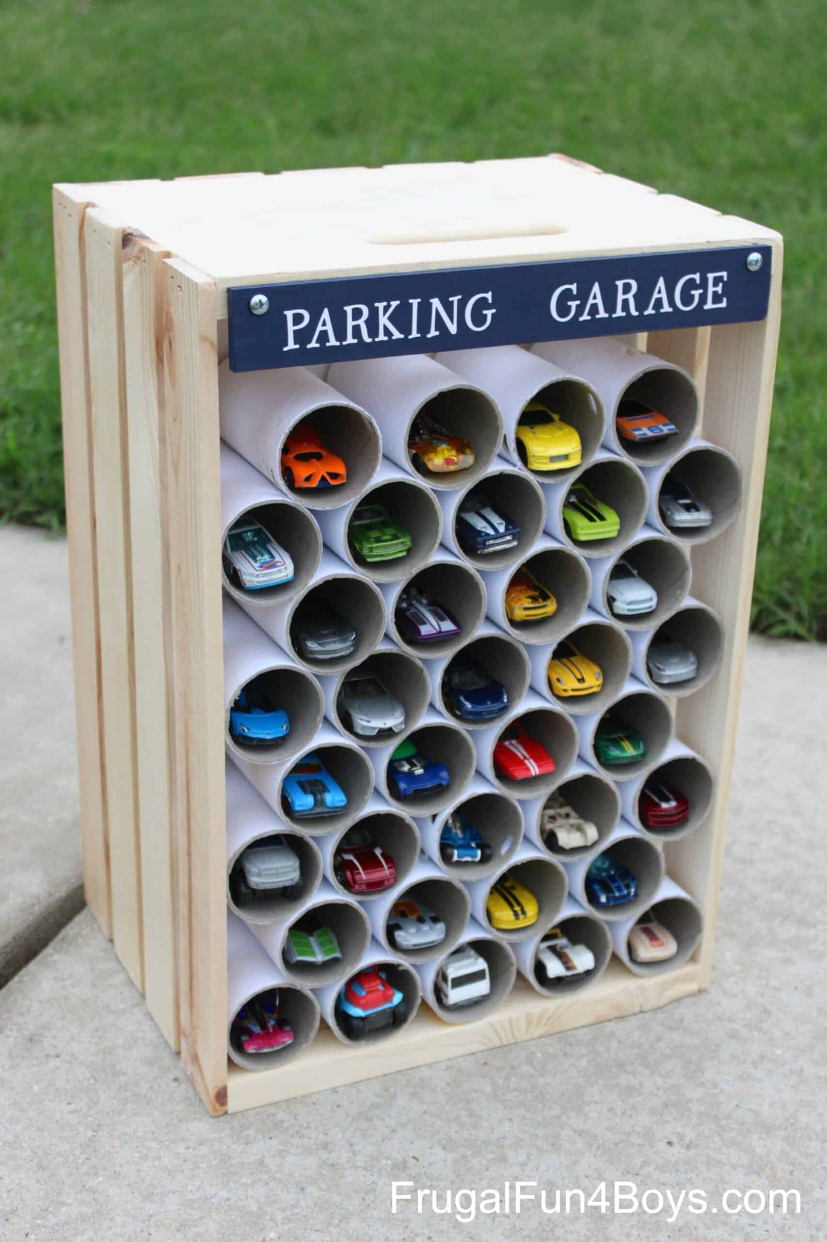 Wooden crate and cardboard pipe toy car parking garage