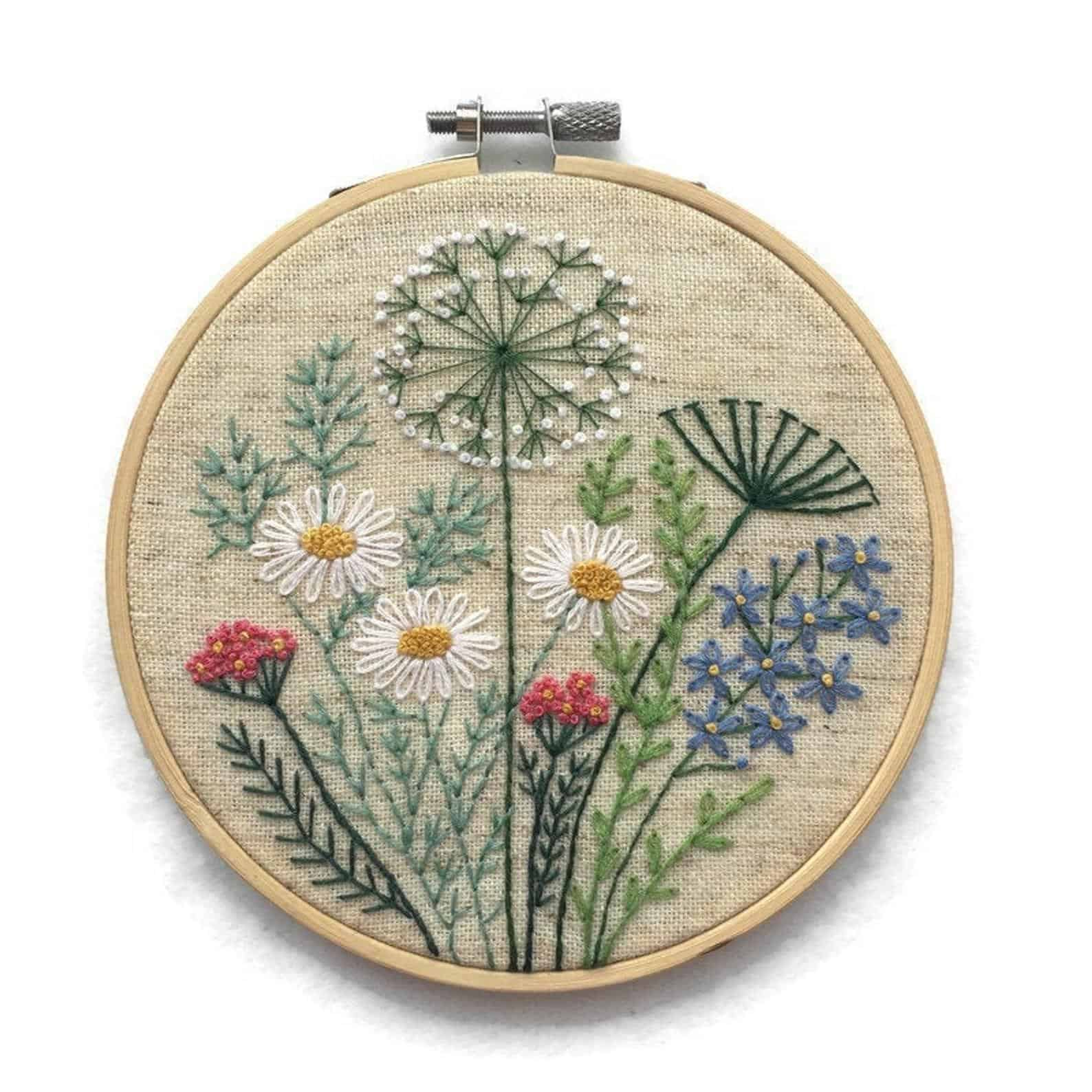 Embroidery of creative flowers and herbs