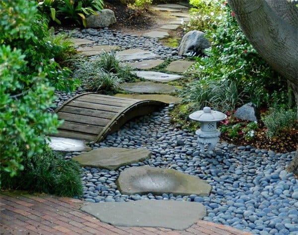 Diy garden bridge with rock walkway
