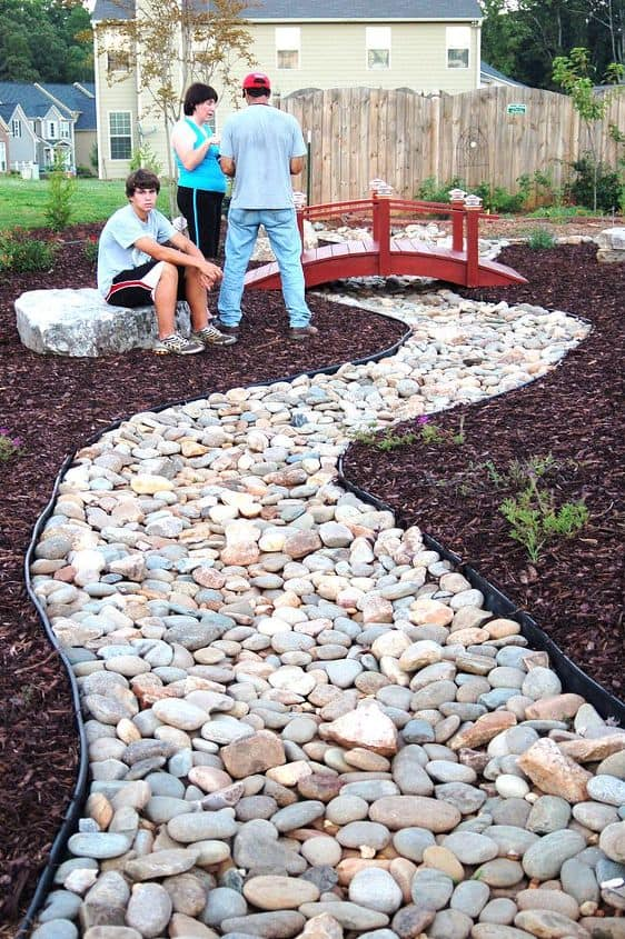 Diy rock garden with a bridge
