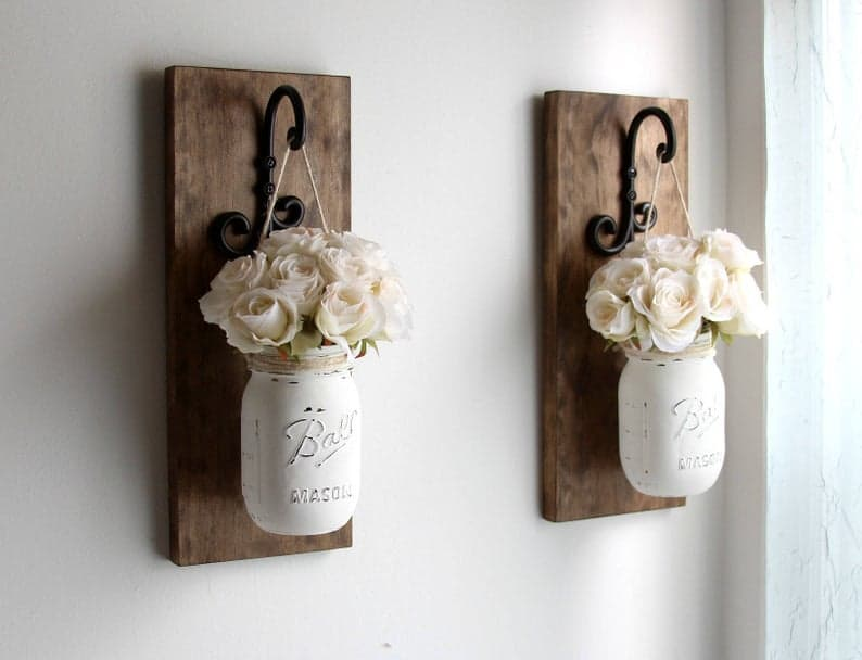 Rustic wooden wall sconces with mason jars