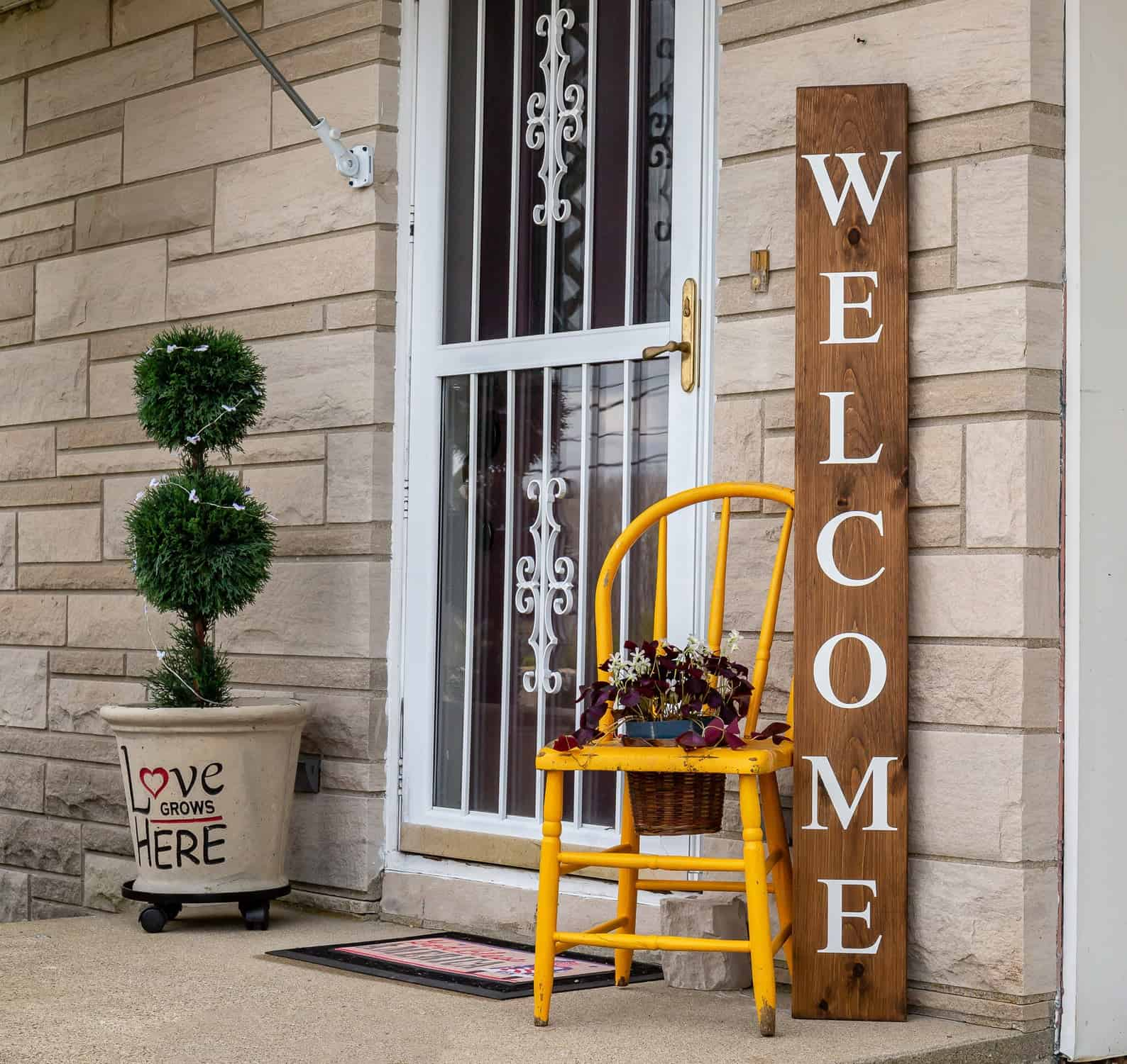 Tall slender welcome sign