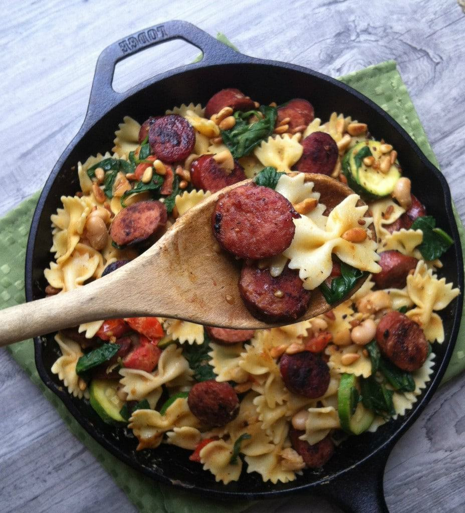 Smoked sausage pasta with white beans, spinch, and pine nuts
