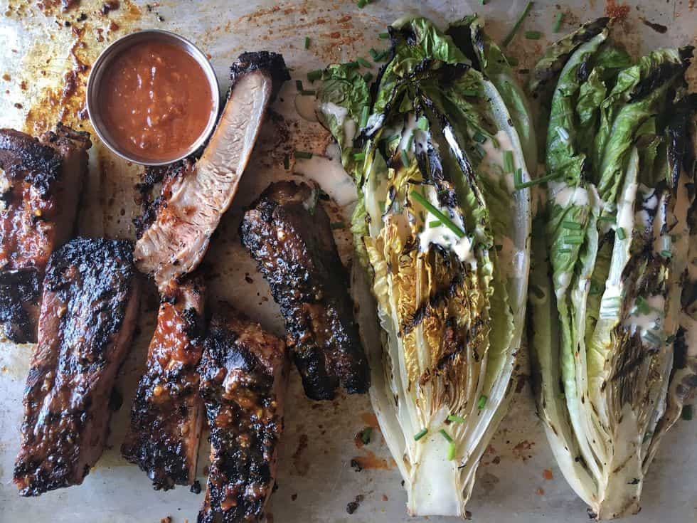 Tasty bbq ribs with grilled romaine