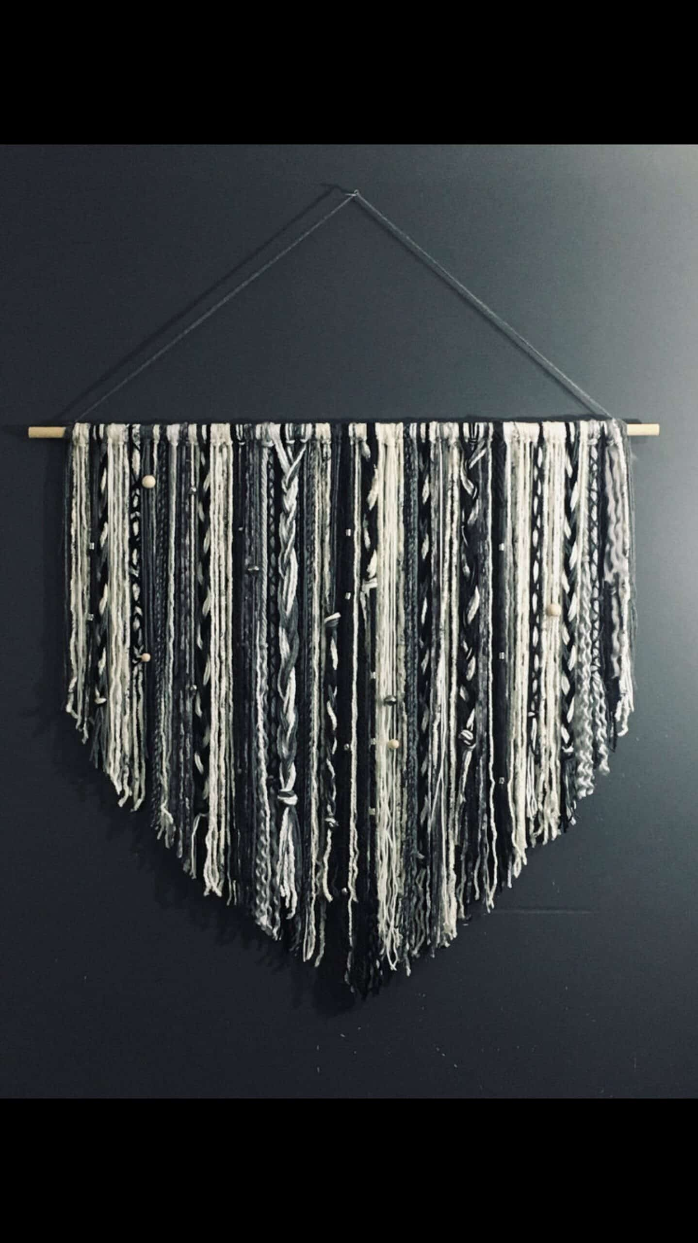 Wall hanging with braids and metal beads
