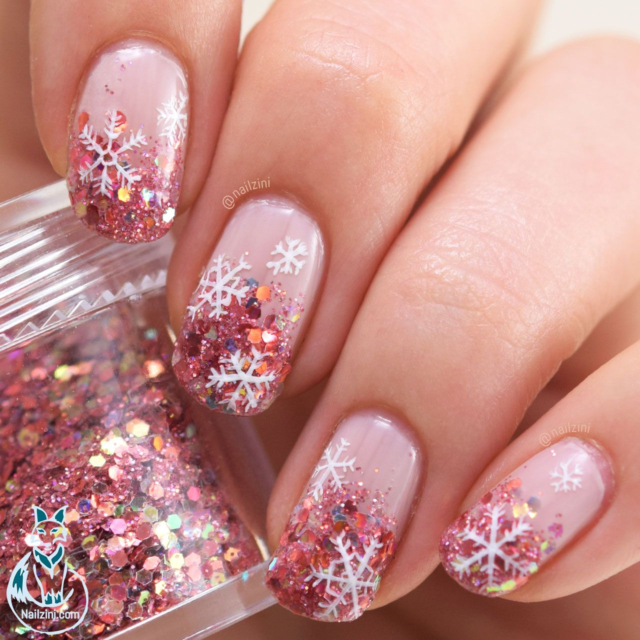 Rose gold glitter with snowflakes nails