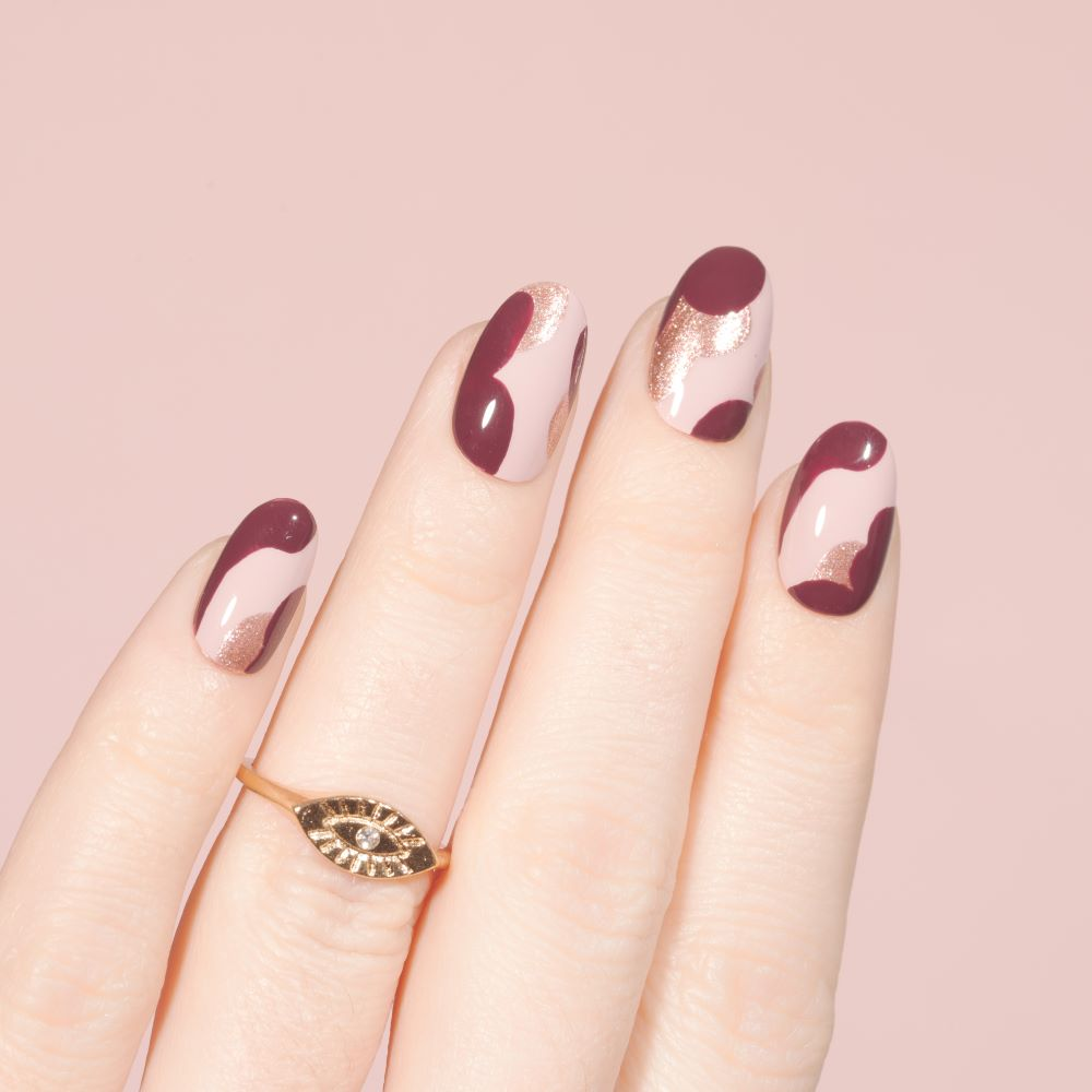 Cranberry and rose gold manicure