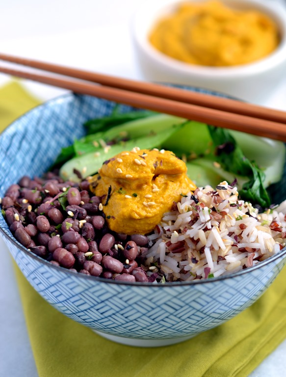 Macro bowl with carrot ginger almond sauce