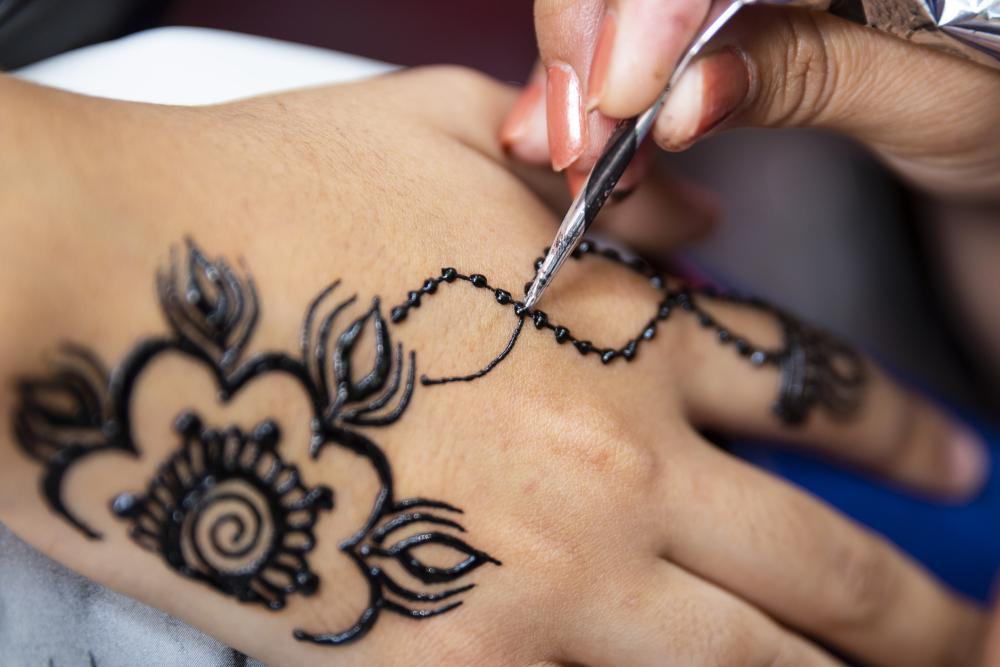 Flower henna hand tattoo