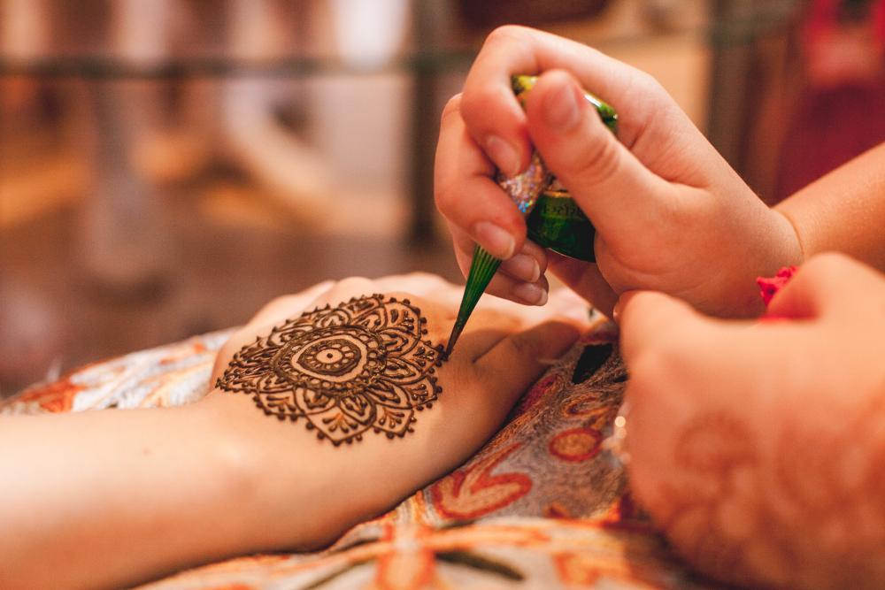 Mandala henna hand tattoo