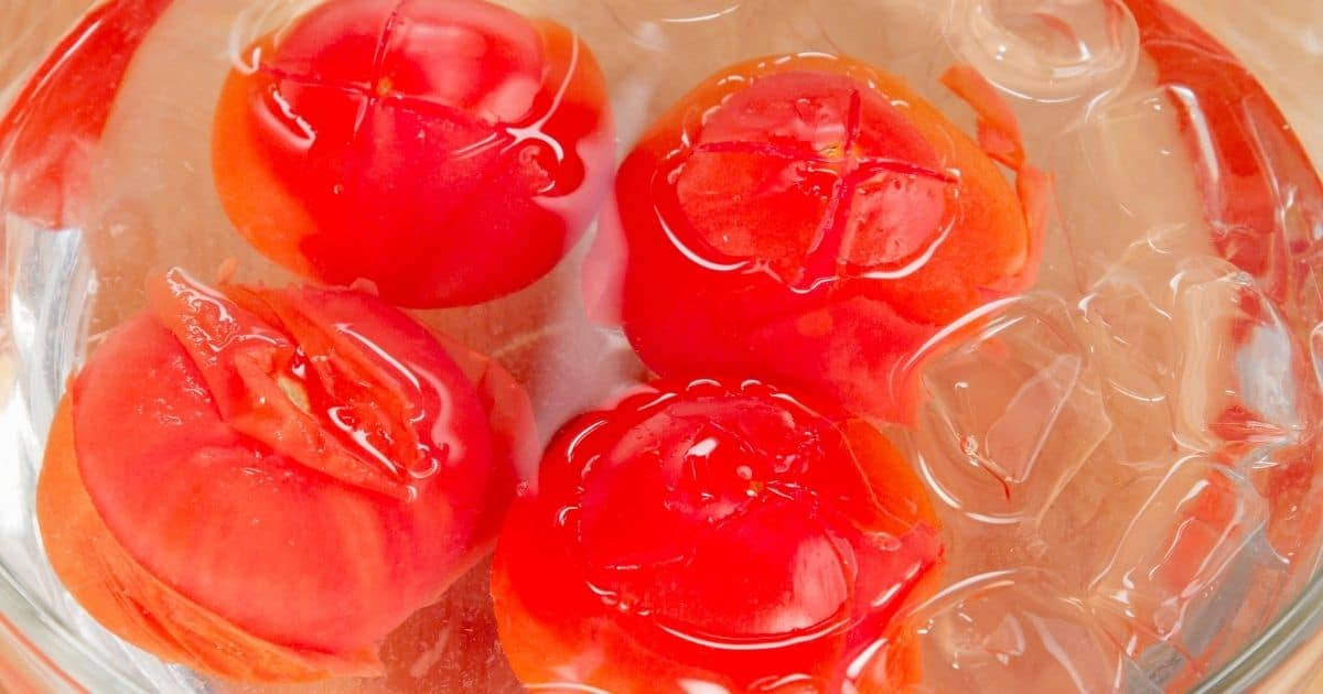 A picture of tomatoes in ice and water