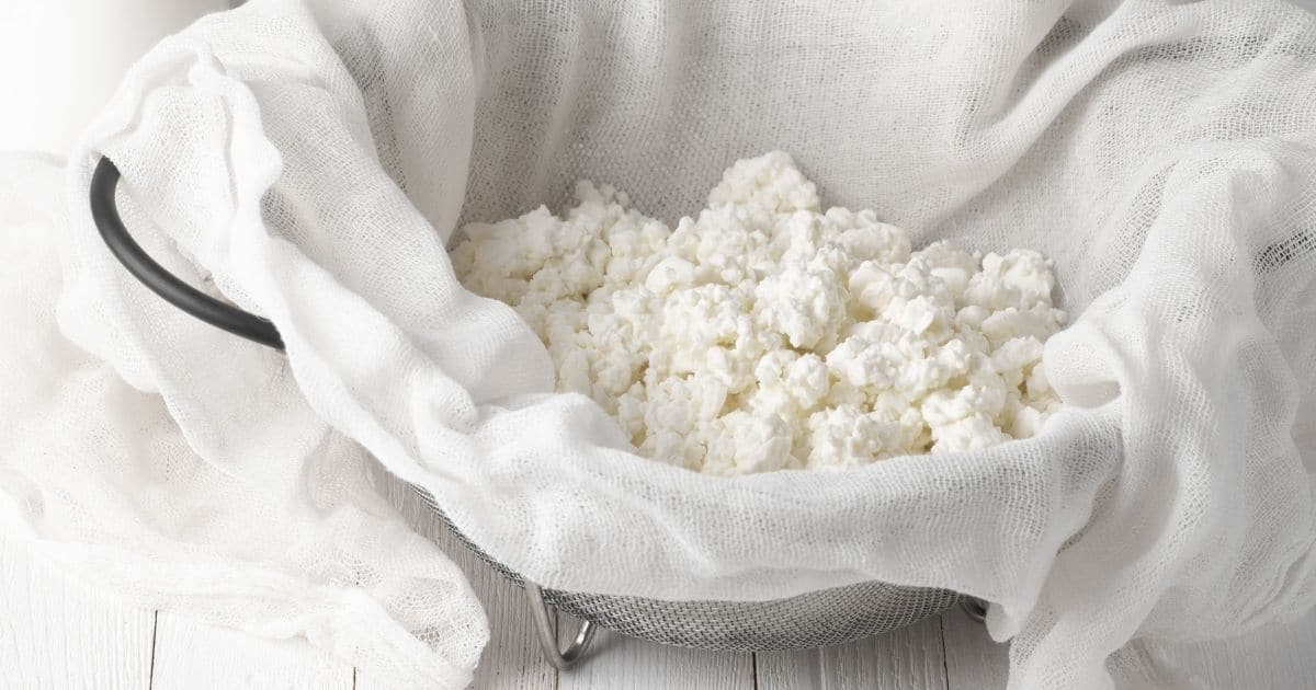 A picture of cottage cheese on a cheesecloth