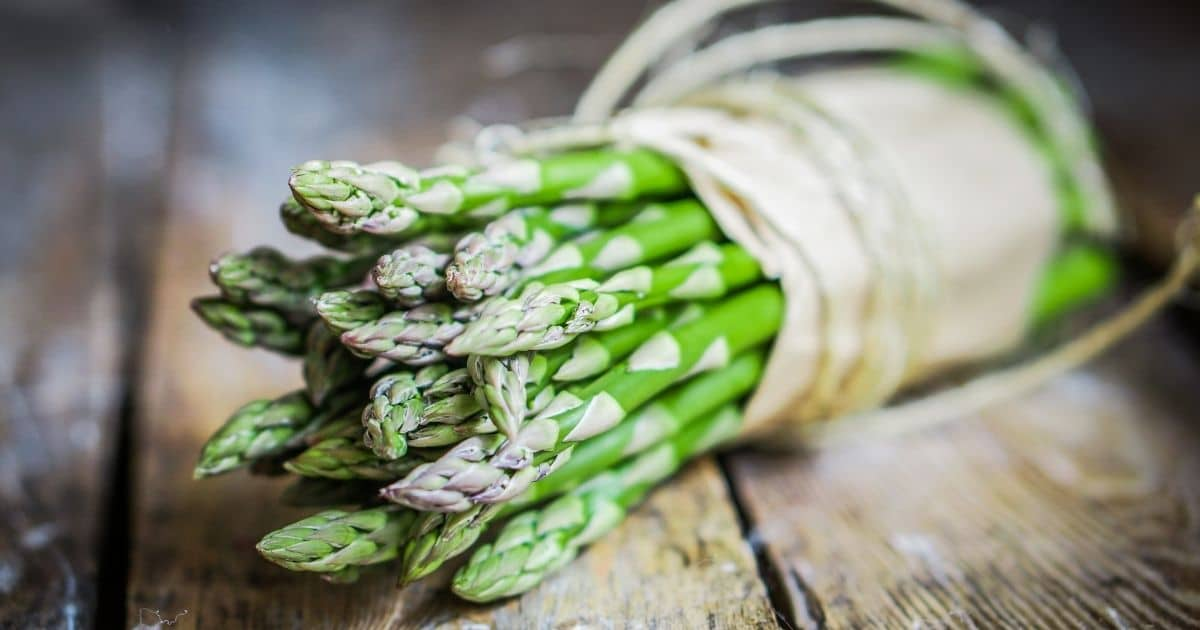 Asparagus wrapped on a paper bag