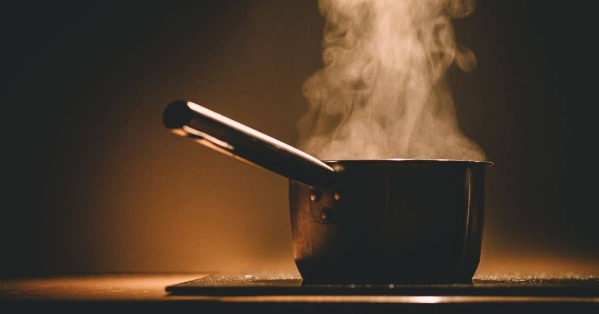 A pot on the stove with boiling water