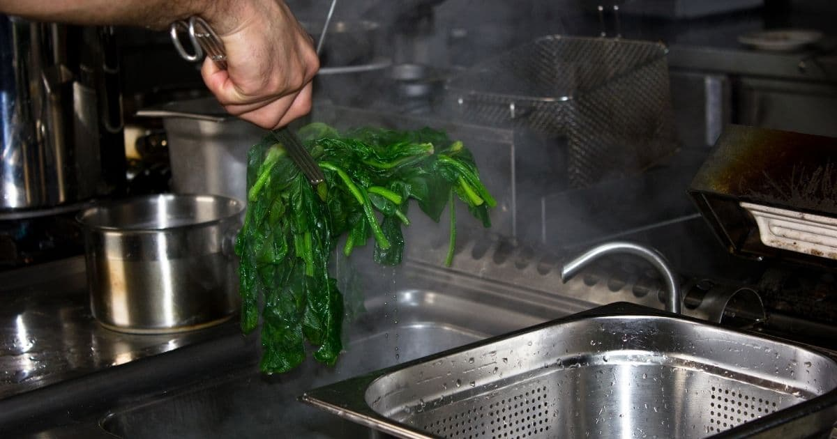 The colander will help remove excess water from the spinach