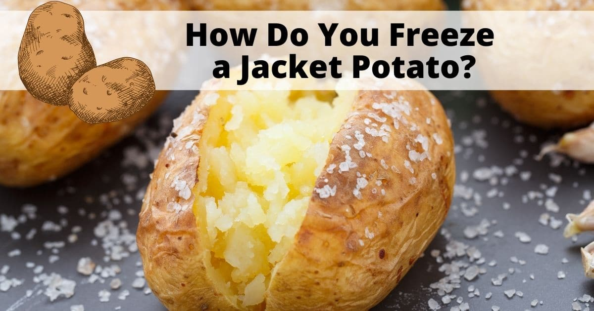 A delicious jacket potato open in half with loads of table salt on the potato and surface
