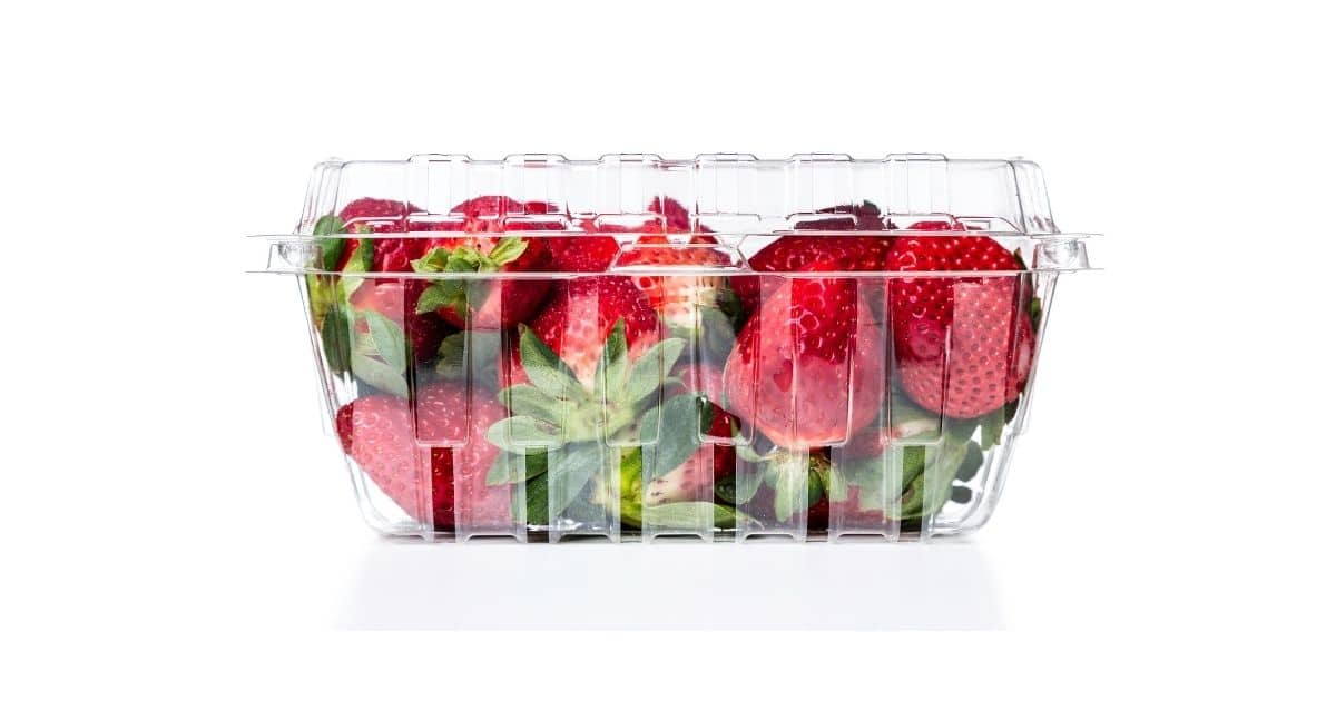 Strawberries in a container being protected form being crashed
